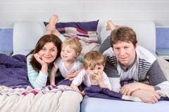 Happy family of a four having fun at home Royalty Free Stock Image