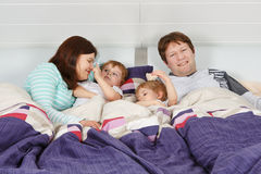 Happy family of a four having fun at home Royalty Free Stock Photos