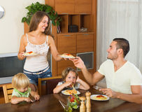 Happy family of four  having lunch Royalty Free Stock Photo