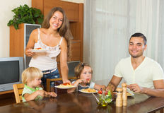 Happy family of four  having lunch Royalty Free Stock Photos