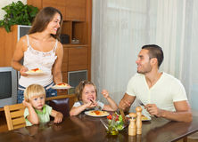 Happy family of four  having lunch Stock Images