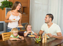 Happy family of four  having lunch Stock Photography