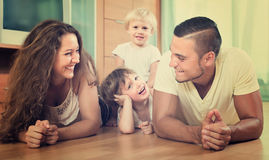 Happy family of four at home Royalty Free Stock Photo