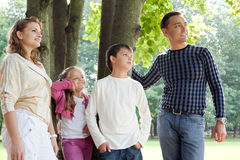 Happy family of four looking aside outdoors Royalty Free Stock Image