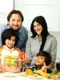 Happy family of four members stock photo