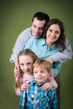 Happy family of four Royalty Free Stock Photos