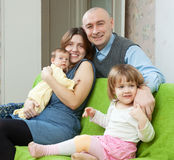 Happy family of four with newborn Stock Photography
