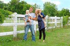 Happy Family Of Four Outside Stock Images