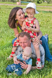 Happy family of four people on the lawn Royalty Free Stock Images