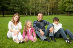 Happy family of four persons outdoors Stock Photo