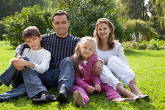 Happy family of four persons outdoors Stock Images