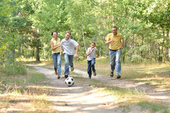 Happy family of four playing Stock Photos