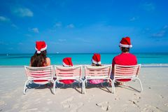 Happy family of four in Santa Hat on summer Stock Photos