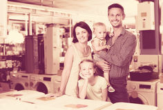 Happy family of four shopping goods in household Stock Images