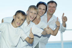 Happy family of four showing thumbs up Royalty Free Stock Photography