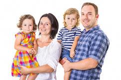 Happy family of four smiling Royalty Free Stock Photos