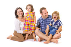 Happy family of four smiling Royalty Free Stock Images
