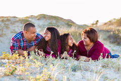 Happy family of four spending time together outdoors Royalty Free Stock Images
