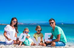 Happy family of four during summer beach vacation Royalty Free Stock Images