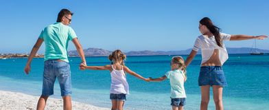 Happy family of four during summer beach vacation Royalty Free Stock Image