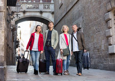 Happy family of four with trunks and bags Royalty Free Stock Photography