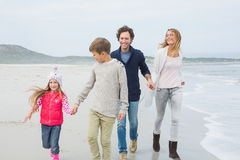 Happy family of four walking at beach Royalty Free Stock Image