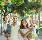 Happy family of four walking with children Stock Image