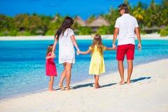 Happy family of four on white beach Royalty Free Stock Photos
