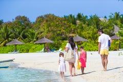 Happy family of four on white beach Royalty Free Stock Photo