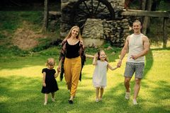 Happy family. Freedom, activity, lifestyle, energy concept. Girls, woman and man smile on summer landscape. Happy childhood, family, love. Mothers and fathers stock photos