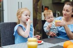 Happy family, fresh fruit breakfast royalty free stock image