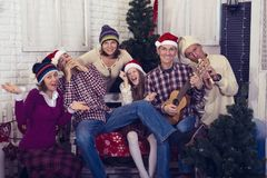 Happy family with friends celebrating a merry Christmas stock images