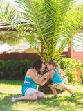 Happy family, friends forever concept. Smiling mother and little son playing together in a park. Royalty Free Stock Image