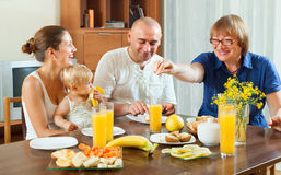Happy family with friuts Stock Photography