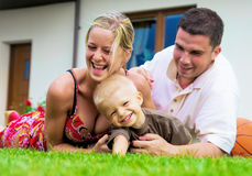 Happy family in front of the house Royalty Free Stock Image