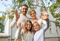 Happy family in front of house outdoors Royalty Free Stock Images