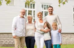 Happy family in front of house outdoors Stock Image