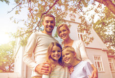 Happy family in front of house outdoors Royalty Free Stock Photo