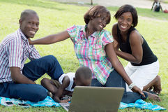 Happy family in front of a laptop. Royalty Free Stock Photography