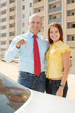 Happy family in front of new home Royalty Free Stock Photos