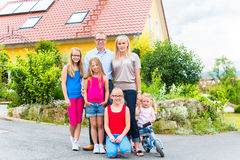 Happy Family in front of their home Royalty Free Stock Photography