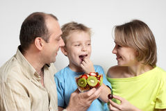 Happy family with fruit salad stock photography