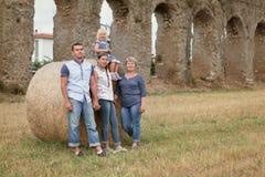 Happy family fun on field with haystacks Stock Photo