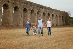 Happy family fun on field with haystacks Stock Photography
