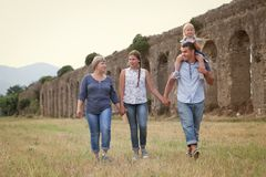 Happy family fun on field with haystacks royalty free stock image