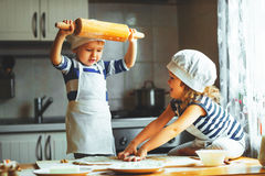 Happy family funny kids bake cookies in kitchen Stock Images