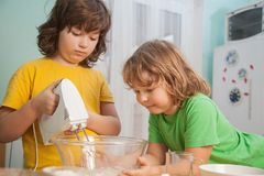 Happy family funny kids are preparing the dough, bake cookies in stock photography