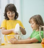 Happy family funny kids are preparing the dough, bake cookies in Royalty Free Stock Images