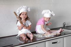 Happy family funny kids are preparing the dough, bake cookies in the kitchen.  Royalty Free Stock Photos