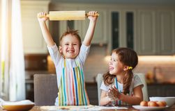 Happy family funny kids bake cookies in kitchen. Happy family  funny kids are preparing the dough, bake cookies in the kitchen royalty free stock photo